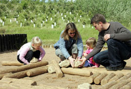 Family playing in sandpit at CONKERS